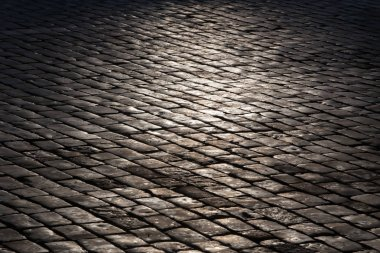 old stone granite pavement. Background close-up.