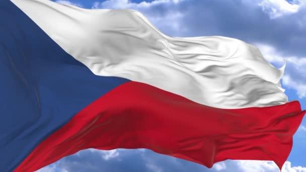 mávání vlajkami ve větru proti modré obloze Česká republika