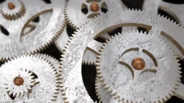 the camera moves along the rotating gears and focuses on the inscription ESTIMATING on the gear