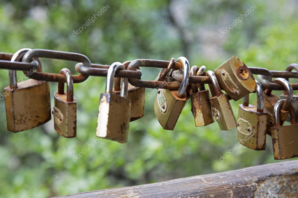 Padlocks adorn the fences and handrails as a sign of good luck.  The World's First Bridge in Zhangjiajie National Forest Park, Hunan, China