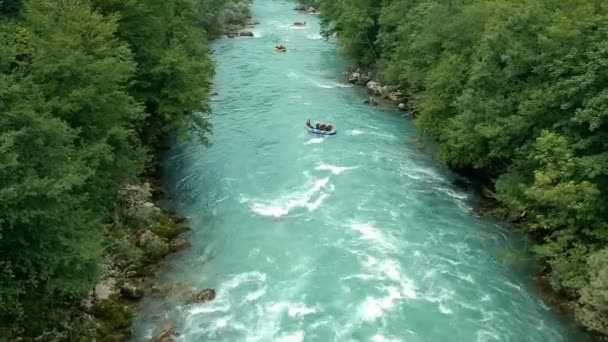 Three Rafting Boats on Whitewater. Aerial shot of people white water rafting on Rouge River. Whitewater rafting teams descending raging rapids with paddles splashing in water.