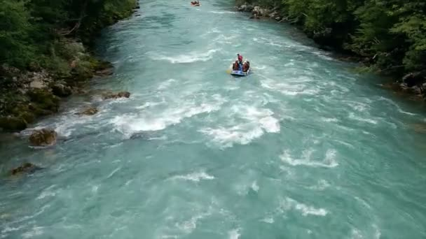 Four Rafting Boats on Whitewater. Whitewater rafting teams descending raging rapids with paddles splashing in water. Aerial shot of people white water rafting.