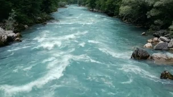 Aerial - Low Flying Following a Raft Going Down Whitewater Rapids River. Team of adult people white water rafting.