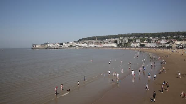 Weston-super-mare beach busy with people in the sea on May bank holiday 2018