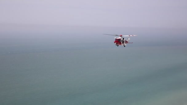 Coastguard rescue helicopter patrols the coastline near Beachy Head, East Sussex, on Saturday 21st April 2018