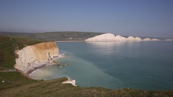 White cliffs Seven Sisters East Sussex uk southern England tourist attraction on a beautiful day with blue sky and sea