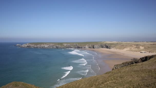 Holywell Bay Cornwall with waves beach and coast on a beautiful day near Perranporth and Newquay