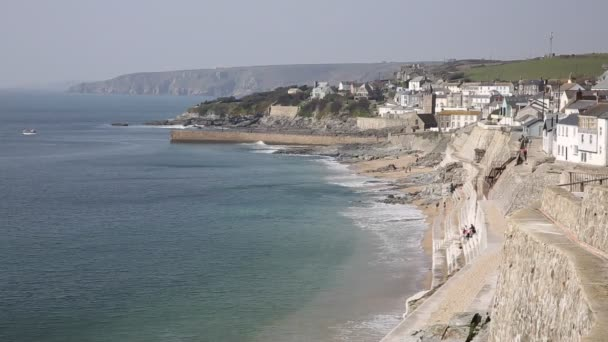 Porthleven Cornwall coast view towards the town with beach and waves
