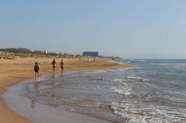 People walking on beautiful natural beach between Torre La mata and Guardamar de Segura Costa Blanca Spain