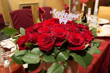 A bouquet of flowers for my mother. The inscription on the bouquet is
