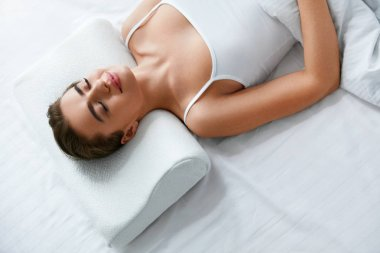 Orthopedic Pillow. Woman Lying On White Pillow In Bed. High Resolution.