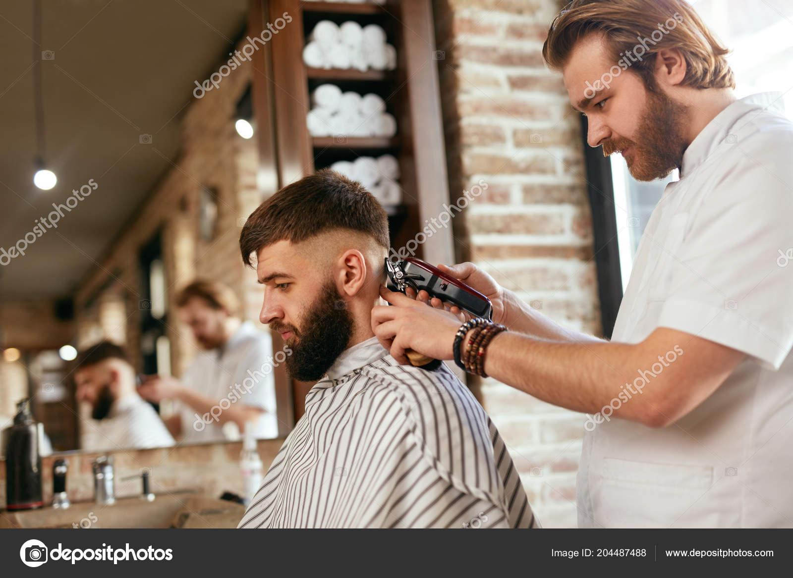 Barber Shop Men Hair Cut Barber Doing Men Fashion Hairstyle Stock