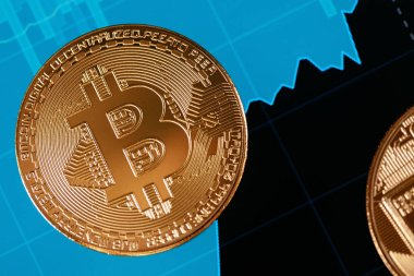 Bitcoin Cryptocurrency Closeup. Coin On Digital Display WIth Financial Exchange Market Analysis Graphics. High Resolution