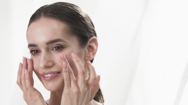 Face Skin Care. Woman Touching Skin Under Eyes Closeup