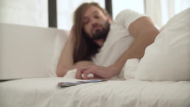 Sleeping Man Wake Up In Bed By Call On Mobile Phone
