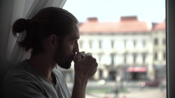 Man Drinking Coffee And Enjoying View From Window