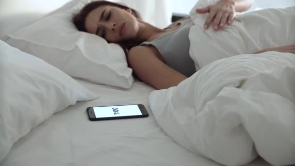 Alarm Clock On Phone. Tired Woman Waking Up In Bed At Bedroom