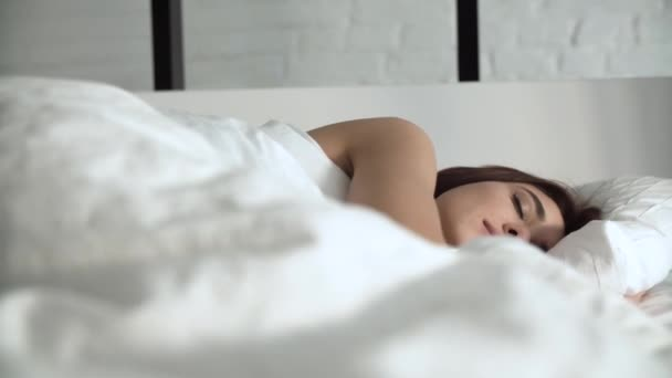 Happy Woman Waking Up In Comfortable Bed With White Linens