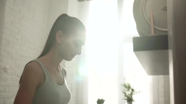 Beautiful Young Woman At Light Sunny Kitchen In Morning