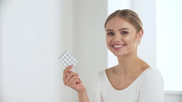 Healthcare. Woman With Blister Of Pills Smiling At Camera