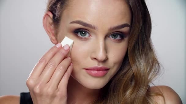 Beauty Makeup. Woman Applying Face Cosmetic With Sponge