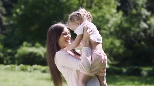 Happy Family. Woman And Kid Hugging And Kissing In Nature