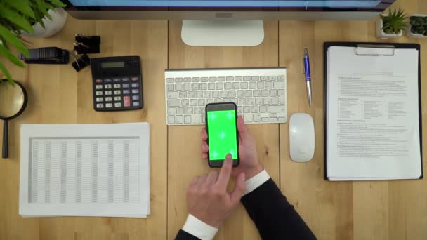 Business Man Using Green Screen Phone And Computer At Office