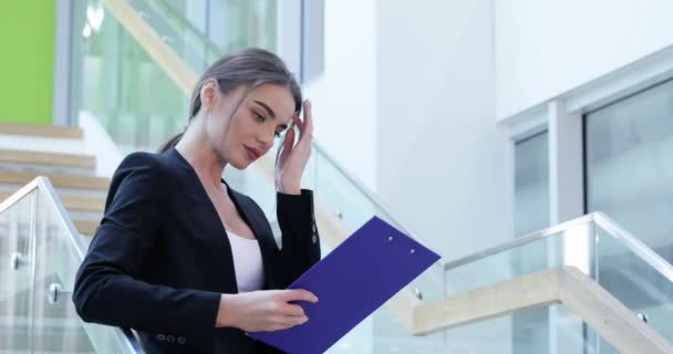 Business Woman With Folder In Hands In Office Building