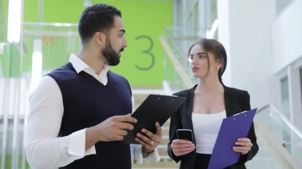 Business Office. Man And Woman With Folders Talking On Stairs