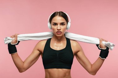 Sport Woman Listening Music In Headphones On Training