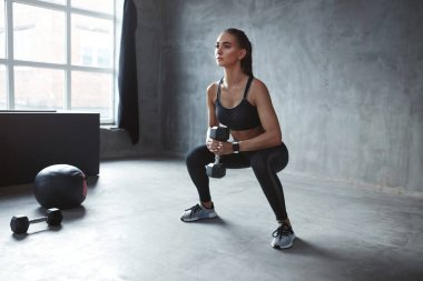Training. Sports Woman In Fashion Sportswear Doing Squats