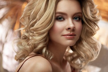 Hair Style And Makeup. Beautiful Blonde Woman With Volume Hair