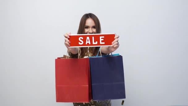 Vásárlás eladás. Boldog asszony táskák és kedvezményes étkezés, kezében