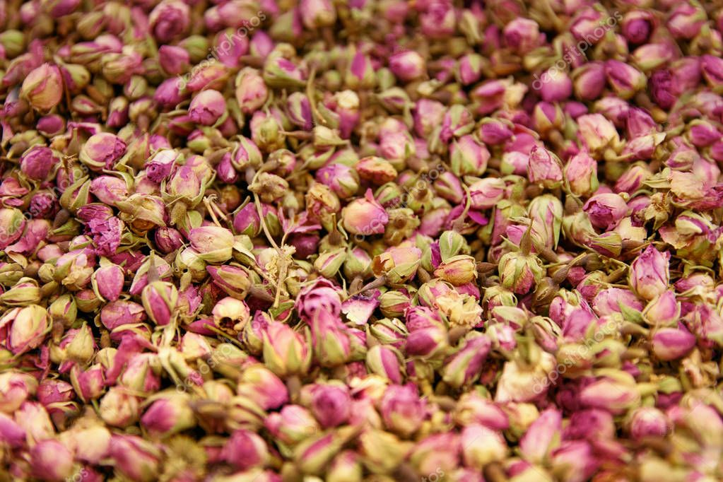 Dried Rose Flowers And Tea Herbs Closeup