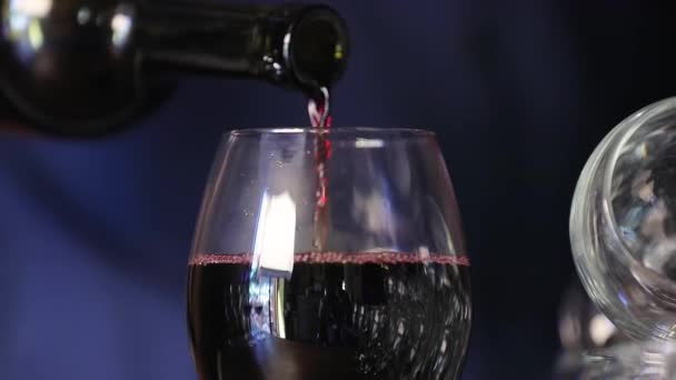 Wine. Closeup Of Red Wine Pouring Into Glass From Bottle