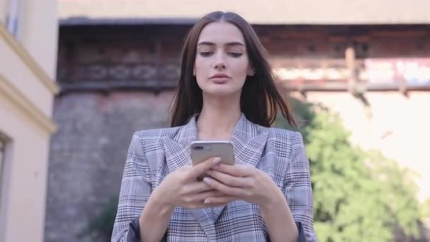Woman With Phone. Beautiful Girl Using Smartphone Outdoors