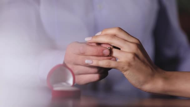 Marriage Proposal. Closeup Man Wearing Ring On Womans Hand