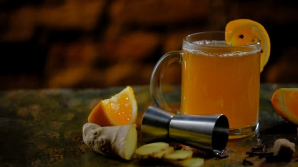 Spicy cocktail with orange, ginger and brown sugar