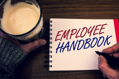Word writing text Employee Handbook. Business concept for Document Manual Regulations Rules Guidebook Policy Code Words notepad hands jumper holding open pen coffe glass desk sketch quick