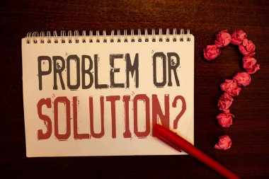 Handwriting text Problem Or Solution Question. Concept meaning Think Solve Analysis Solving Conclusion Reddish paper balls structures question mark red pen notebook browny desk