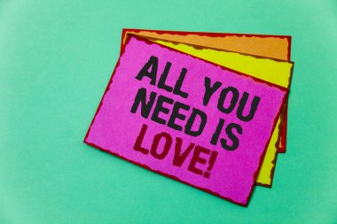 Writing note showing  All You Need Is Love Motivational. Business photo showcasing Deep affection needs appreciation romance Ideas message communicate feelings thought reflection green background