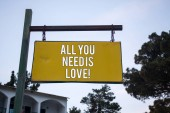 Photo Word writing text All You Need Is Love Motivational. Business concept for Deep affection needs appreciation romance Wooden board hang hanging post ideas messages feelings trees blue sky