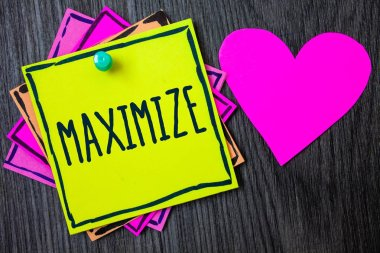 Handwriting text writing Maximize. Concept meaning Increase to the greatest possible amount or degree Make larger Border sticky remember cards love heart pinned dark woody background