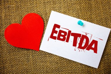 Conceptual hand writing showing Ebitda. Business photo text Earnings Before Interest Taxes Depreciation Amortization Abbreviation Message note jute background red heart letters love grunge idea