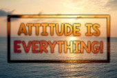 Writing note showing  Attitude Is Everything. Business photo showcasing Personal Outlook Perspective Orientation Behavior Sunset blue beach cloudy sky ideas message thoughts feelings