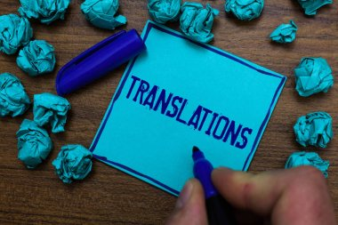 Text sign showing Translations. Conceptual photo Written or printed process of translating words text voice Cyan paper object thoughts crumpled papers ideas mistakes several tries