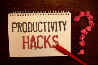 Handwriting text Productivity Hacks. Concept meaning Hacking Solution Method Tips Efficiency Productivity Reddish paper balls structures question mark red pen notebook browny desk