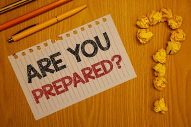 Conceptual hand writing showing Are You Prepared Question. Business photo text Ready Preparedness Readiness Assessment Evaluation Words written Note Desk Pen Pencil Question mark Crumbled paper