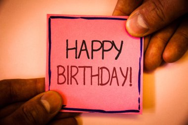 Text sign showing Happy Birthday Motivational Call. Conceptual photo Congratulations Celebrating Anniversary Man hold holding pink paper ideas black red letters frame shadow on wall