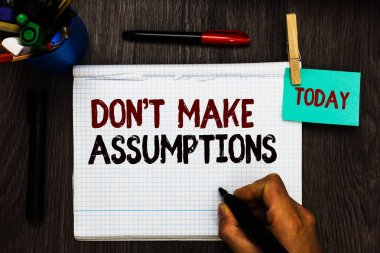 Conceptual hand writing showing Don t not Make Assumptions. Business photo text putting plan in future with percentage happening Register pages handwriting text work stationery items woody table